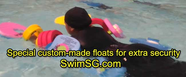 SwimSG.com - Swimming classes adults senior with special floats singapore